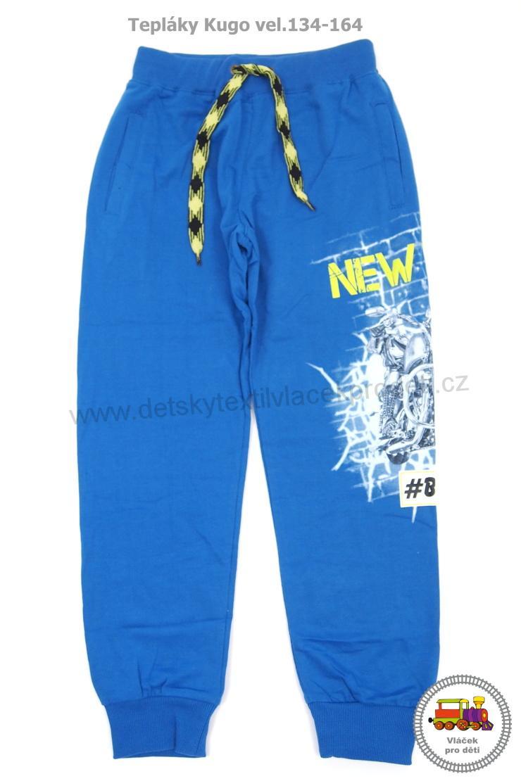 Chlapecké tepláky Kugo M8022 modré vel.134 8e4089b408